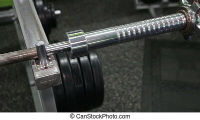 Closeup of female athlete's hand as she grips the weightlifting bar