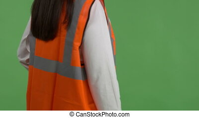 Closeup of female construction manager or engineer against green screen