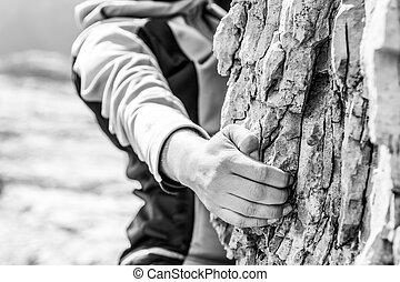 Closeup of female hand rock climbing.