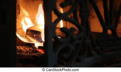 Closeup of firewood burning in fire.