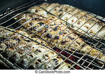 closeup of fish on barbecue grill