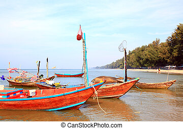 closeup of fisherman long tail boat on the beach