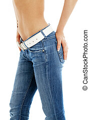 closeup of fit lady in blue jeans with white belt