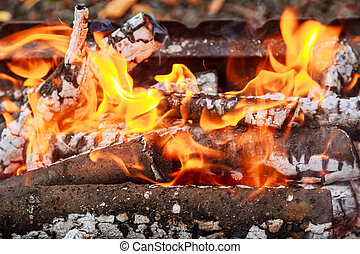 Closeup of flames burning on black background, slow motion.