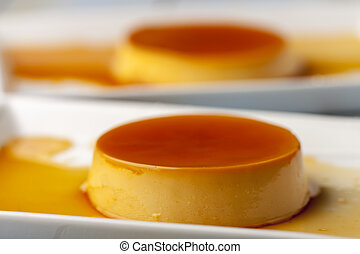closeup of flan dessert on plates