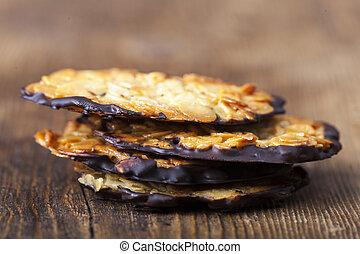closeup of florentiner cookies on wood