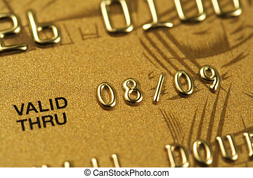 Closeup of fragment of gold credit card. Very shallow depth...