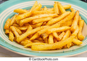 Closeup of frech fries on ceramic dish