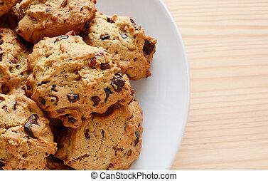 Closeup of fresh chocolate chip and pecan cookies
