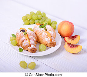 Closeup of fresh fruit croissant on white background