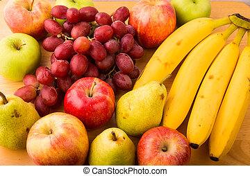 Closeup of fresh fruit on a wood table