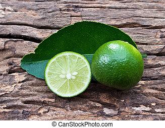 closeup of fresh lemons on wood