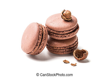 Closeup of fresh macaroons with nut on white background