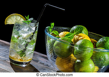 Closeup of fresh mojito drink with citrus fruits