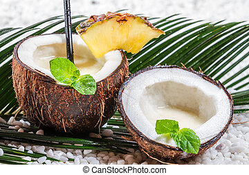 Closeup of fresh pinacolada drink served in a coconut