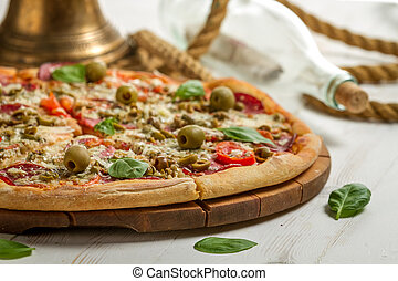 Closeup of fresh pizza on a boat