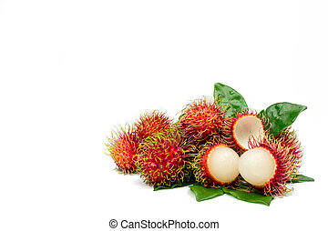 Closeup of fresh red ripe rambutan with leaves isolated on white background with clipping path. Thai sweet fruits. Tropical fruit.