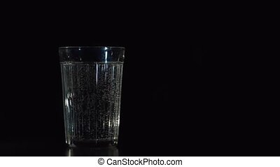 Closeup of fresh sparkling water glass.