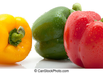 fresh yellow, orange and green pepper with water drops isolated on white background