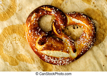 Closeup of Freshly baked home soft pretzel with salt on...