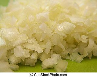 Closeup of freshly chopped onion, on chop board