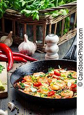 Closeup of freshly fried shrimps on pan