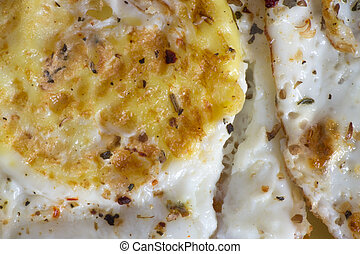 Closeup of fried eggs with seasoning. Delicious and healthy breakfast.