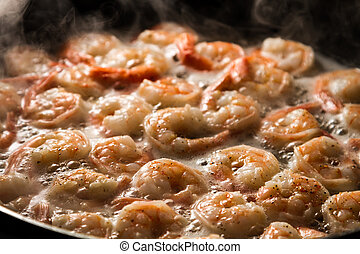 Closeup of fried shrimps in butter on a frying pan