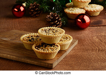 fruit tarts with christmas decorations
