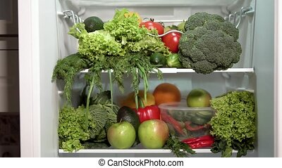 Closeup of Full Fridge - Closeup of full fridge, fresh and...