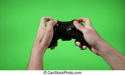 Closeup of gamer hands playing videogame pressing remote...