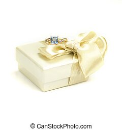 Closeup of gift box and ring on a white background
