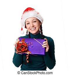 Closeup of girl holding a Christmas gift isolated on white background