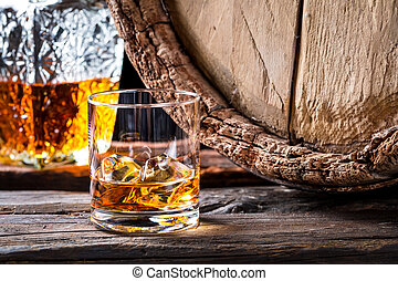 Closeup of glass of good cognac in the distillery basement