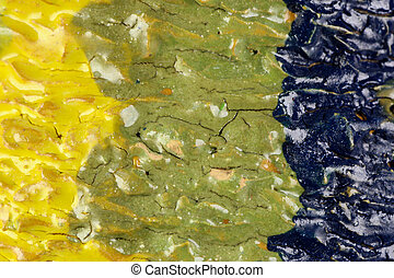 Detail of glazed ceramics in green, blue and yellow.