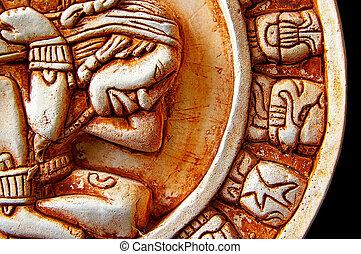 Closeup of glyphs on a Mayan calendar