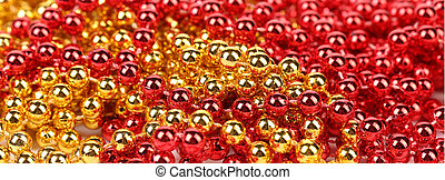 Closeup of gold and red beads.