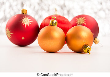 Closeup of golden and red Christmas balls on a white background