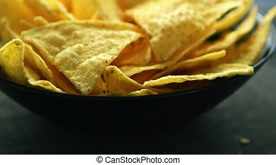 Closeup of golden chips - Closeup shot of bowl filled with...