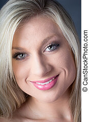 Closeup of Gorgeous Blond green eyes smile