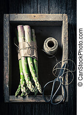 Closeup of green asparagus in a wooden box