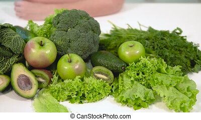 Closeup of Green Food on Table - Closeup of green fruit and...