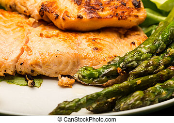 Closeup of grilled salmon with asparagus
