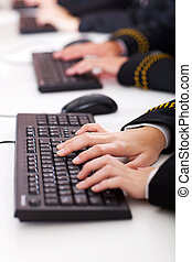 high school students typing on keyboard