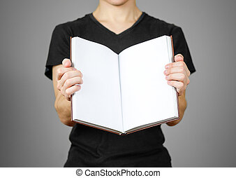 Closeup of guy in black t-shirt holding blank open white book on isolated background. Education concept. Mock up