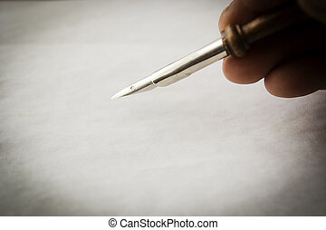 Closeup of hand with fountain pen