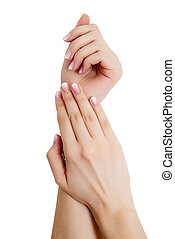closeup of hands of a young woman with long pink manicure on nails against white background