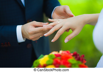 Closeup of hands of bridal couple with wedding rings stock