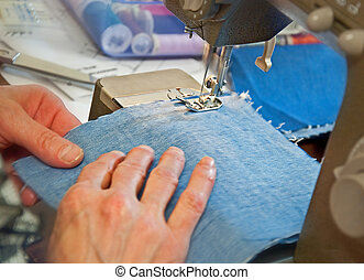 Closeup of Hands Sewing on Machine