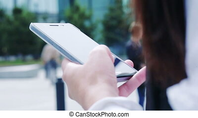 Closeup of hands typing on mobile device in business...